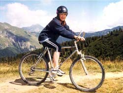 Girl cycling in the Alp's near Morzine