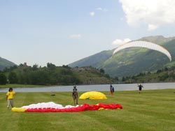 Paragliders landing near Saint-Lary-Soulan in the Pyrenees France