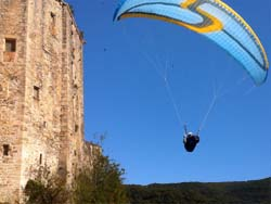 Paraglider flying past a chateau in France