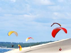 paraglider fly on holiday on the Dune de Pyla France.