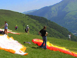 paragliding students flying the pyrenees on holiday in France