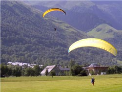 Paragliders landing in the Pyrenees France.