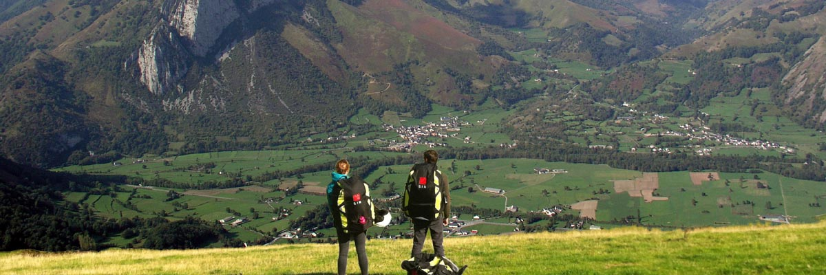 2 students view take off on the Pyrenees mountains, south west France.