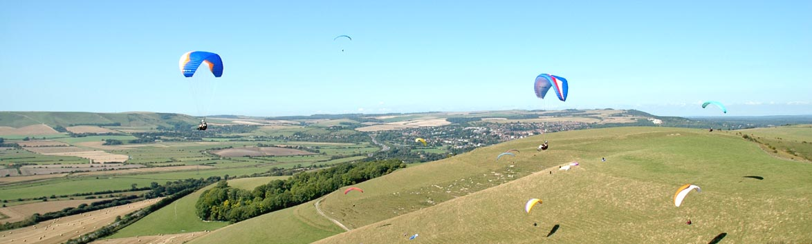 Paragliders flying at mt Caburn near Lewis East Sussex