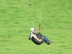 Student demonstrates ground handeling a Paraglider.